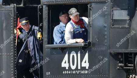 The crew of the Big Boy, No. 4014 arrives during the commemoration of the 150th anniversary of the Transcontinental Railroad completion at Union Station, in Ogden, Utah