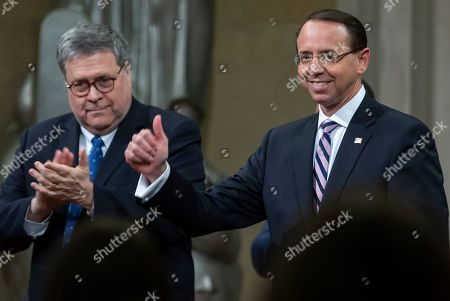 Deputy Attorney General Rod Rosenstein (R) reacts with US Attorney General William Barr (L) during Rosenstein's 'Farewell Ceremony' at the Department Justice in Washington, DC, USA, 09 May 2019. Rosenstein oversaw Special Counsel Robert Mueller after former Attorney General Jeff Sessions recused himself from the Russian election interference investigation.