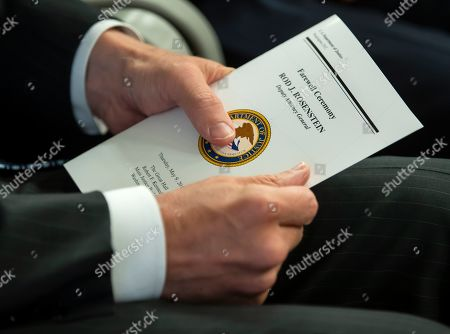 An attendee holds a program during a  'Farewell Ceremony' for Deputy Attorney General Rod Rosenstein at the Department Justice in Washington, DC, USA, 09 May 2019. Rosenstein oversaw Special Counsel Robert Mueller after former Attorney General Jeff Sessions recused himself from the Russian election interference investigation.