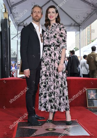 Anne Hathaway, Adam Shulman. Actress Anne Hathaway, right, and her husband Adam Shulman pose atop her new star on the Hollywood Walk of Fame following a ceremony, in Los Angeles