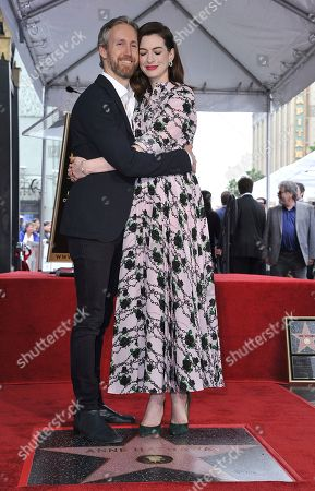 Anne Hathaway, Adam Shulman. Actress Anne Hathaway, right, and her husband Adam Shulman hug as they pose atop her new star on the Hollywood Walk of Fame following a ceremony, in Los Angeles