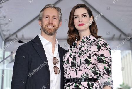 Anne Hathaway, Adam Shulman. Actress Anne Hathaway, right, and her husband Adam Shulman attend a ceremony honoring Hathaway with a star on the Hollywood Walk of Fame, in Los Angeles