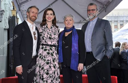 Stock Photo of Anne Hathaway, Adam Shulman, Kate McCauley Hathaway, Gerald Hathaway. Actress Anne Hathaway, second left, poses with her family, from left, husband Adam Shulman, mother Kate McCauley Hathaway and father Gerald Hathaway following a ceremony honoring her with a star on the Hollywood Walk of Fame, in Los Angeles