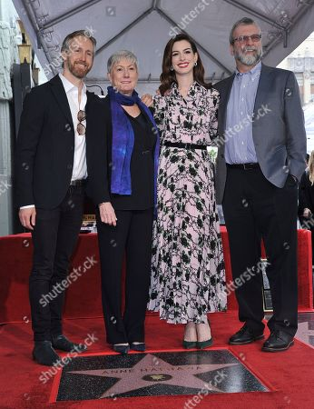 Anne Hathaway, Adam Shulman, Kate McCauley Hathaway, Gerald Hathaway. Actress Anne Hathaway, second right, poses atop her new star on the Hollywood Walk of Fame with her family, from left, husband Adam Shulman, mother Kate McCauley Hathaway and father Gerald Hathaway following a ceremony, in Los Angeles