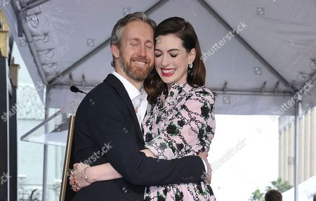 Anne Hathaway, Adam Shulman. Actress Anne Hathaway, right, and her husband Adam Shulman hug following a ceremony honoring Hathaway with a star on the Hollywood Walk of Fame, in Los Angeles