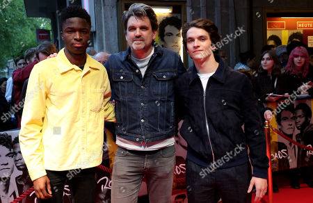 Stock Picture of Stephane Bak, German director and producer Sebastian Schipper and British actor Fionn Whitehead pose during the premiere of 'Roads' at the Lichtburg Cinema in Essen, Germany, 09 May 2019.