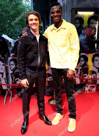 Fionn Whitehead (L) and French actor Stephane Bak (R) pose during the premiere of 'Roads' at the Lichtburg Cinema in Essen, Germany, 09 May 2019.