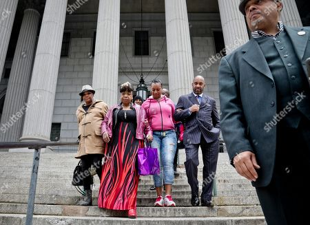 Gwen Carr, Michael Garner, Ellisha Garner. Gwen Carr, second from left, mother of Eric Garner- an unarmed black man who died as he was being subdued in a chokehold by police officer Daniel Pantaleo nearly five years ago, is escorted arm-in-arm as she leaves court with family members, in New York. Judge Joan Madden cleared the way for a police disciplinary trial to begin next week for Pantaleo, after rejecting his claim that a police watchdog agency didn't have jurisdiction to prosecute the case