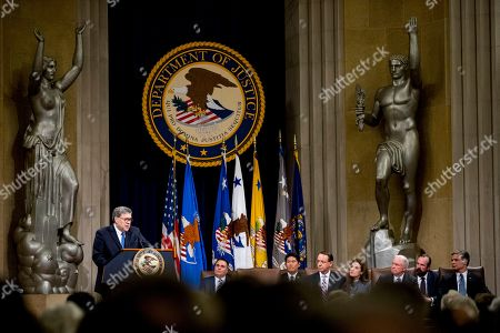 Rod Rosenstein, William Barr, Jeff Sessions. Attorney General William Barr, left, accompanied by former Attorney General Jeff Sessions, third from right, FBI Director Christopher Wray, right, and Deputy Attorney General Rod Rosenstein, fifth from right, speaks during a farewell ceremony for Rosenstein in the Great Hall at the Department of Justice in Washington, . Rosenstein is set to step down as Deputy Attorney General May 15th