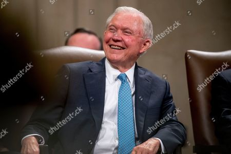 Former Attorney General Jeff Sessions smiles during a farewell ceremony for Deputy Attorney General Rod Rosenstein in the Great Hall at the Department of Justice in Washington, . Rosenstein is set to step down as Deputy Attorney General May 15