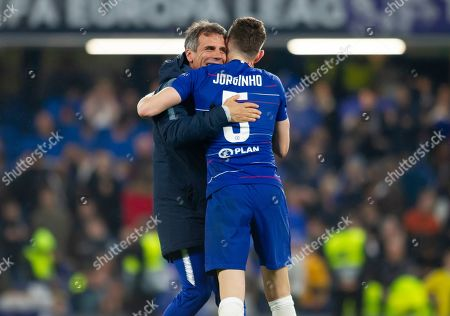 chelsea assistant coach Gianfranco Zola celebrates with Jorginho of Chelsea following the win in a penalty shootout against Eintracht Frankfurt
