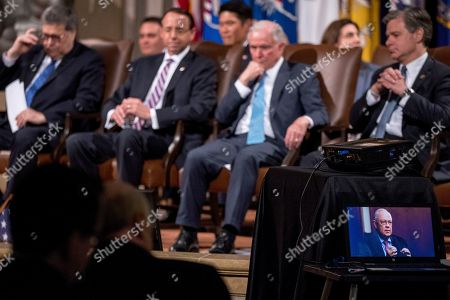 Rod Rosenstein, William Barr, Jeff Sessions, Christopher Wray. From right, Attorney General William Barr, Deputy Attorney General Rod Rosenstein, former Attorney General Jeff Sessions, and FBI Director Christopher Wray watch a tribute video where Former independent counsel Kenneth Starr, bottom right, speaks during a farewell ceremony for Rosenstein in the Great Hall at the Department of Justice in Washington, . Rosenstein is set to step down as Deputy Attorney General May 15th