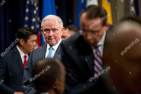 William Barr, Jeff Sessions. Former Attorney General Jeff Sessions, left, watches Deputy Attorney General Rod Rosenstein, foreground, as he greets guests following a farewell ceremony for Rosenstein in the Great Hall at the Department of Justice in Washington, . Rosenstein is set to step down as Deputy Attorney General May 15th