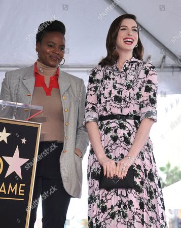 Anne Hathaway, right, and writer/director Dee Rees attend a ceremony honoring Hathaway with a star on the Hollywood Walk of Fame, in Los Angeles