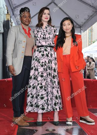 Dee Rees, Awkwafinam Anne Hathaway. Actress Anne Hathaway, center, writer/director Dee Rees, left, and actress Awkwafina, right, pose atop Hathaway's new star on the Hollywood Walk of Fame following a ceremony, in Los Angeles