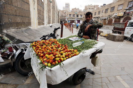 A peddler displays peaches for sale at a market during the fasting month of Ramadan, in Sana'a, Yemen, 09 May 2019. Muslims around the world celebrate the holy month of Ramadan by praying during the night time and abstaining from eating, drinking, and sexual acts during the period between sunrise and sunset. Ramadan is the ninth month in the Islamic calendar and it is believed that the revelation of the first verse in Koran was during its last 10 nights.
