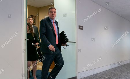 """Senate Intelligence Committee Vice Chair Mark Warner, D-Va., who leads the panel with Republican Chairman Richard Burr of North Carolina, departs after a meeting at committee's secure facility on Capitol Hill in Washington, . Republicans are lashing out at Burr for his committee's subpoena of President Donald Trump's son to answer questions about his 2017 testimony to the panel as part of its probe into Russian election interference, a move that suggests the Russia investigation is not """"case closed"""" as some in the GOP insists"""