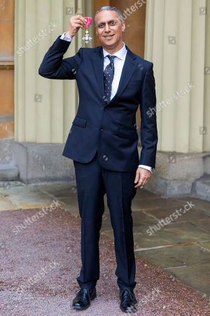 Stock Picture of Musician and composer Nitin Sawhney proudly displays his OBE for services to music at an investiture ceremony conducted by Prince William at Buckingham Palace