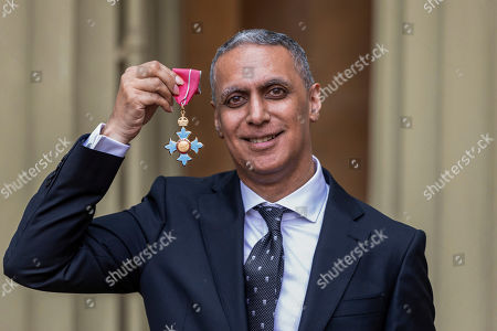 Stock Photo of Musician and composer Nitin Sawhney proudly displays his OBE for services to music at an investiture ceremony conducted by Prince William at Buckingham Palace