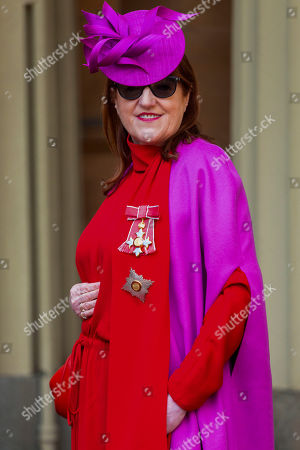 Harpers Bazaar Editor in Chief Glenda Bailey was invested as a Dame for services to the GREAT Britain campaign and UK prosperity, charity, fashion and journalism at an investiture ceremony conducted by Prince William, Prince William at Buckingham Palace. Hat by Philip Tracey, Dress by Valentino, bag by Gabriela Hearst, shoes by Jimmy Choo