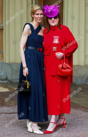 Harpers Bazaar Editor in Chief Glenda Bailey, right, with 'best friend' Gabriela Hearst, was invested as a Dame for services to the GREAT Britain campaign and UK prosperity, charity, fashion and journalism at an investiture ceremony conducted by Prince William, Prince William at Buckingham Palace. Hat by Philip Tracey, Dress by Valentino, bag by Gabriela Hearst, shoes by Jimmy Choo