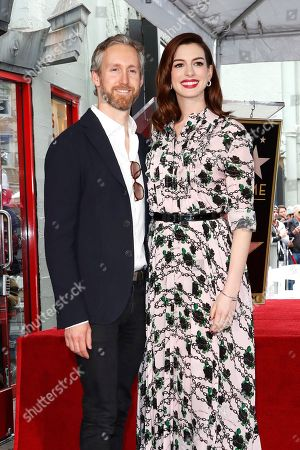 Anne Hathaway (R) poses with husband Adam Shulman (L) as she receives the 2,663rd Star on the Hollywood Walk of Fame in Hollywood, California, USA, 09 May 2019. The star was dedicated in the Category of Motion Pictures