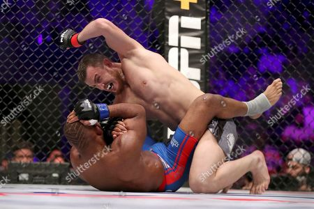 Magomed Magomedkerimov, top, in action against John Howard during their regular season mixed martial arts bout at PFL 1, at the Nassau Coliseum (NYCB Live) in Uniondale, NY. Magomedkerimov won via first round submission