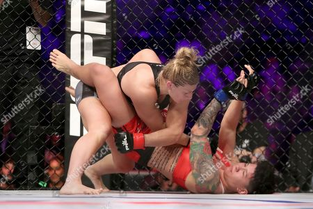 Kayla Harrison, top, in action against Larissa Pacheco during their regular season mixed martial arts bout at PFL 1, at the Nassau Coliseum (NYCB Live) in Uniondale, NY. Harrison won via unanimous decision