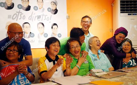 "Florin Hilbay, Lydia Hilbay, Melanie Aquino, Erin Tanada, Zeny Tanada, Jose Manuel Diokno, Mench Diokno, Samira Gutoc, Tomanina Gutoc. Opposition senatorial candidates embrace their loved ones to pay tribute to mothers ahead of Sunday's celebration of Mother's Day in Makati city east of Manila, Philippines. The opposition candidates received a boost Friday from the Roman Catholic church after Manila Archbishop Cardinal Ramon Tagle issued a pastoral letter to priests encouraging the faithful to pray for peaceful conduct of elections and ""consider"" the ""People's Choice Movement"" of ten senators in Monday's midterm elections. Monday's election is largely seen as a test on President Rodrigo Duterte's hold to his leadership. From left, candidate Florin Hilbay with his mother Lydia, Melanie Aquino holding a cutout of her son Benigno Aquino IV, Erin Tanada with his mother Zeny, Jose Manuel Diokno with his eldest sister Mench and Samira Gutoc with her mother Tomanina"