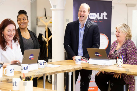 Prince William meeting, from left, Jo Irwin, Amanda Brown-Bennet and Carol Keith who are Crisis Volunteers working with Shout, a free text messaging service which aims to provide 24/7 support for anyone experiencing mental health crisis.