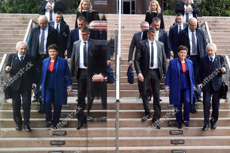 Deputy Prime Minister Beata Szydlo of Poland (2-R) and Polish ambassador to Hungary Jerzy Snopek (R) are reflected as they arrive at the Europe of Central Europe conference in Larus Convention Center in Budapest, Hungary, 10 May 2019.