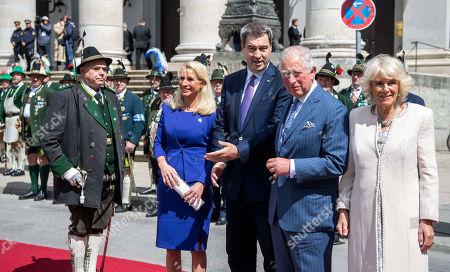 Bavarian Prime Minister Markus Soeder, Mrs. Karin Baumueller-Soeder, Prince Charles, Camilla Duchess of Cornwall at a reception at the Max-Joseph-Platz, Munich