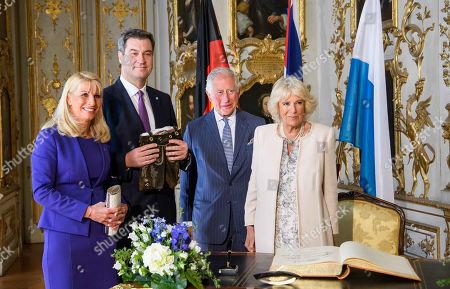 Stock Photo of Bavarian Prime Minister Markus Soeder, Mrs. Karin Baumueller-Soeder, Prince Charles, Camilla Duchess of Cornwall at a reception at the Max-Joseph-Platz, Munich