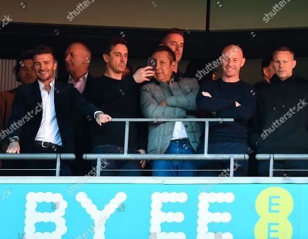 Salford City owners celebrate as they wait for the trophy lift. From left David Beckham, Gary Neville, Peter Lim, Nicky Butt and Ryan Giggs