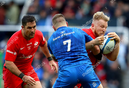 Jackson Wray is tackled by Sean O'Brien of Leinster as Saracens captain Brad Barritt looks on