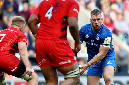 Sean O'Brien of Leinster in action against Jackson Wray and Will Skelton (R) of Saracens