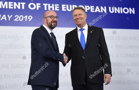 Belgian Prime Minister Charles Michel, left, is welcomed by Romanian President Klaus Ioannis