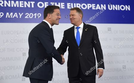 Prime Minister of Netherlands, Mark Rutte, left, is welcomed by Romanian President Klaus Ioannis