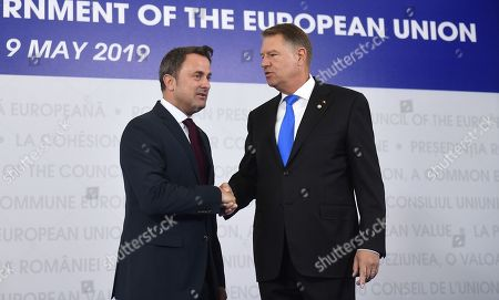 Prime Minister of Luxembourg, Xavier Bettel, left, is welcomed by Romanian President Klaus Ioannis