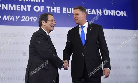President of the Republic of Cyprus Nicos Anastasiades, left, is welcomed by Romanian President Klaus Ioannis