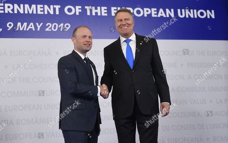Prime Minister of Malta, Joseph Muscat, left, is welcomed by Romanian President Klaus Ioannis