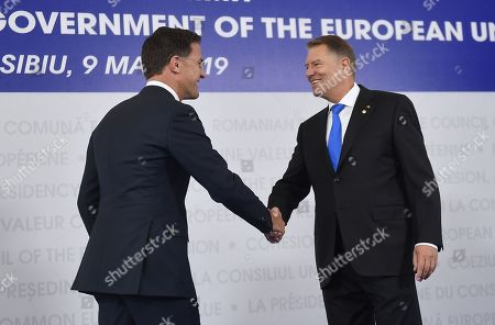 Stock Image of Prime Minister of Netherlands, Mark Rutte, left, is welcomed by Romanian President Klaus Ioannis