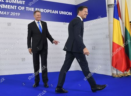 Stock Image of Prime Minister of Netherlands, Mark Rutte, right, is welcomed by Romanian President Klaus Ioannis