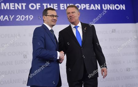 Stock Photo of Prime Minister of Poland, Mateusz Morawiecki, left, is welcomed by Romanian President Klaus Ioannis