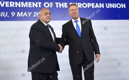 Bulgarian Prime Minister Boyko Borissov, left, is welcomed by Romanian President Klaus Ioannis