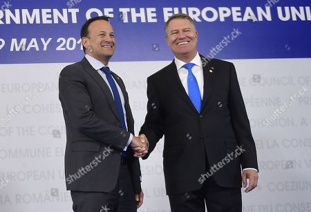 Stock Photo of Irish Prime Minister Leo Varadkar, left, is welcomed by Romanian President Klaus Ioannis