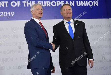 Stock Picture of Latvian Prime Minister Arturs Krisjanis Karins, left, is welcomed by Romanian President Klaus Ioannis