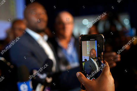 Mmusi Maimane, leader of the largest opposition party, the Democratic Alliance, speaks to the media as he visits the Independent Electoral Commission Results Center in Pretoria, South Africa . The ruling African National Congress held a comfortable lead in South Africa's presidential and parliamentary election with more than two-thirds of the vote counted Thursday, but the incomplete count showed the party received less support than in the last balloting five years ago