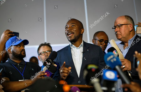 Mmusi Maimane, leader of the largest opposition party, the Democratic Alliance, addresses the media as he visits the Independent Electoral Commission Results Center in Pretoria in Pretoria, South Africa . The ruling African National Congress is coasting to a comfortable lead in South Africa's presidential and parliamentary elections with 80% of the vote counted, but the ongoing tally shows the party getting less support than in the previous poll five years ago