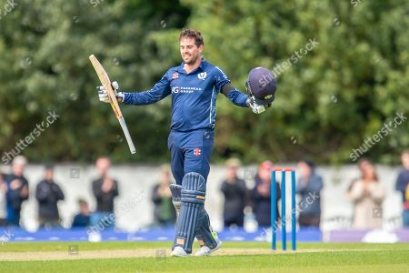 Scotland's Donald MacLeod celebrates after scoring 100 runs during the One Day International match between Scotland and Afghanistan at The Grange Cricket Club, Edinburgh